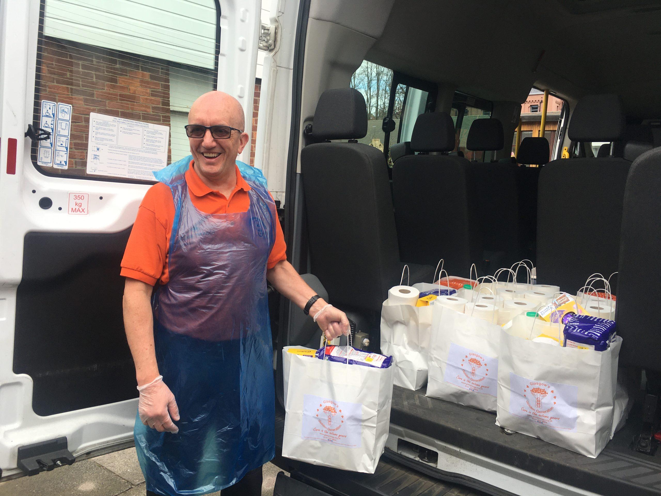 John is delivering food packs